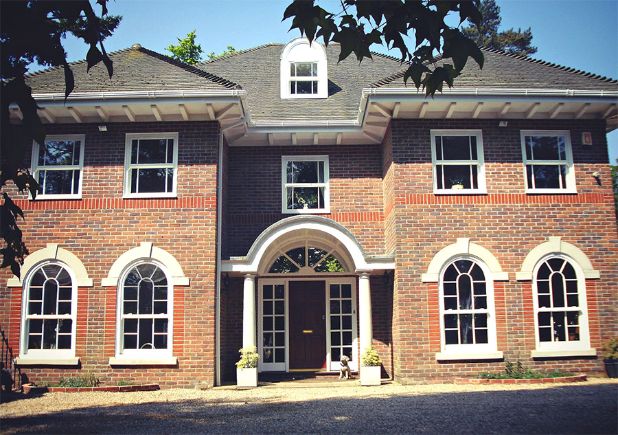 Heritage rose windows on brick house